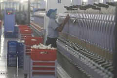 Garment Industry Development in absorbing labor. Workers check the thread during the manufacturing process the fabric in the garment industry in Solo, Central Stock Photography