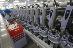 Garment Industry Development in absorbing labor. Workers check the thread during the manufacturing process the fabric in the garment industry in Solo, Central Royalty Free Stock Image