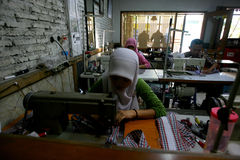 Garment. Labour was working in a garment company in the city of Solo, Central Java, Indonesia stock photography