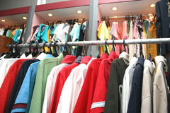 Garments. Hanging in a clothing shop stock photos