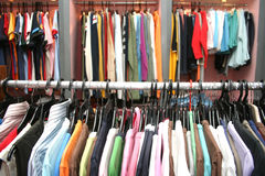 Garments. Hanging in a clothing shop stock image