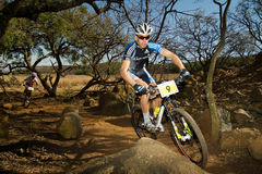 Garmin Team Rider through rock garden Stock Images