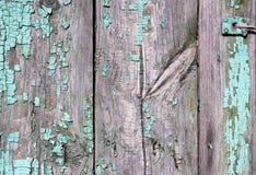 Garnering beståndsdel, stad Trästaketet med spårar av tid Grönt grått Kan användas som en bakgrund arkivbild