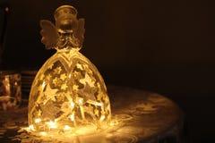 Garnering för jul för ängelexponeringsglaslampa arkivbild