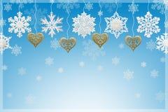 Garneringar för jul och för nytt år: snöflingor och guld- hjärtor Arkivfoto
