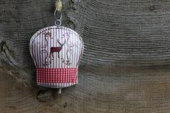 Garneringhjortar för glad jul på Tin Bell Arkivbild