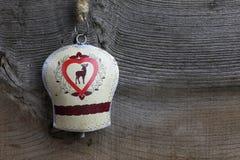 Garneringhjortar för glad jul på Tin Bell Royaltyfria Bilder