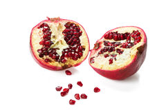 Garnet. Halves of a pomegranate, and the grain in front of him Stock Photos