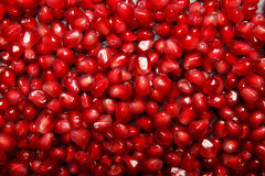 Garnet background. Pomegranate background. Juicy red pomegranate seeds. Natural fruity ingredients for healthy juices. Stock Image