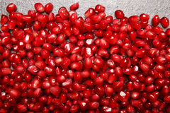 Garnet background. Pomegranate background. Juicy red pomegranate seeds. Natural fruity ingredients for healthy juices. Royalty Free Stock Image