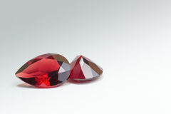 Garnet gem stone in grey background Stock Photo