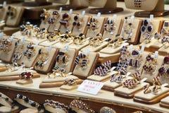 Garnet jewelry in store window Stock Photography
