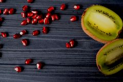 Garnet and kiwi fruits on the table. Healthy food. Useful fruits. Ingredients for fresh. Healthy lifestyle Royalty Free Stock Images