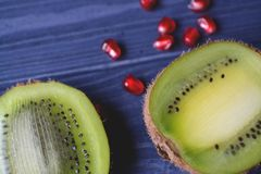Garnet and kiwi fruits on the table. Healthy food. Useful fruits. Ingredients for fresh. Healthy lifestyle Royalty Free Stock Photography