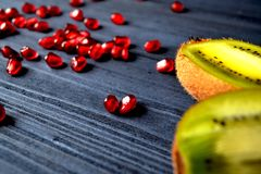 Garnet and kiwi fruits on the table. Healthy food. Useful fruits. Ingredients for fresh. Healthy lifestyle Stock Photos