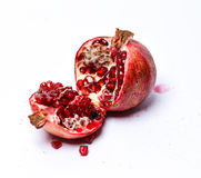 Garnet. Pomegranate isolated on a white background Stock Images