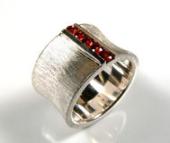 Garnet ring. Ring with round red garnets channel set in in white gold Stock Photography
