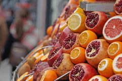Garnets, mandarins and oranges. Ripe juicy garnets, mandarins and oranges are cut on sale at the counter of a fruit shop on the street of Istanbul Royalty Free Stock Images
