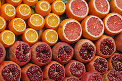 Garnets, mandarins and oranges. Ripe juicy garnets, mandarins and oranges are cut on sale at the counter of a fruit shop on the street of Istanbul royalty free stock image