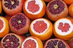 Garnets, mandarins and oranges. Ripe juicy garnets, mandarins and oranges are cut on sale at the counter of a fruit shop on the street of Istanbul stock photo