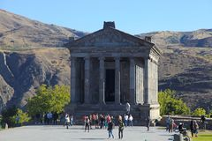 Tourists at Ancient hellenistic Garni pagan Temple in Armenia Royalty Free Stock Image