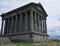 Garni temple in Armenia. The view of the Garni temple from the rear side with the tourist Royalty Free Stock Images
