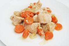 Garnish of Broiled Chicken Carrots with Carrots and Onion Sauce. Selective focus. Homemade Food. Chicken Meat. . Garnish of Broiled Chicken Carrots with Carrots Royalty Free Stock Photography