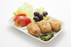 Garnish and croquettes Stock Images