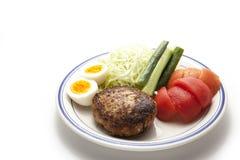 Garnish and hamburger steak Royalty Free Stock Image