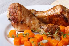 Garnish with pumpkin and thyme and roasted chicken legs closeup Stock Images