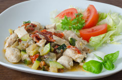 Garnished chicken with dried tomatoes and vegetables Stock Images