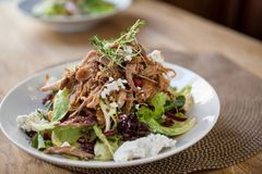 Garnished Chicken Salad At Table Stock Image