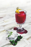 Garnished cocktail on white background Stock Photo