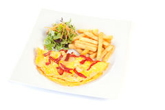 Garnished crepe. With fried chips and salad royalty free stock image
