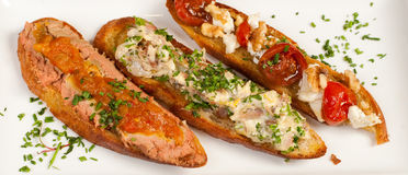Garnished Crostini toasts Stock Images