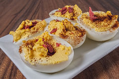 Garnished deviled eggs,plate,cutting board Stock Image