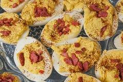Garnished deviled eggs,platter,table Stock Image