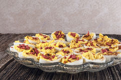 Garnished deviled eggs,platter,table Royalty Free Stock Photo