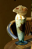 Garnished ice cream in a glass. Scoops of ice cream in a tall sundae glass decorated with a garnish Stock Images