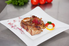 Garnished Meat In Plate On Kitchen Counter Royalty Free Stock Photos