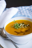 Garnished pumpkin Soup in Tea Cup Stock Photo