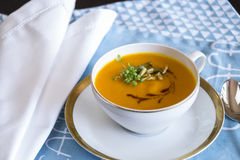 Garnished pumpkin Soup in Tea Cup Royalty Free Stock Image