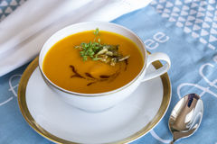 Garnished pumpkin Soup in Tea Cup Royalty Free Stock Photo