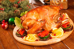 Garnished roasted turkey. On table stock photo