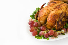Garnished roasted turkey with grapes and herbs Royalty Free Stock Photos