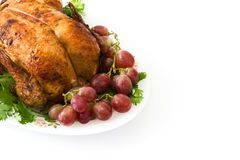 Garnished roasted turkey with grapes and herbs Stock Image