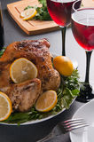 Garnished roasted turkey on holiday decorated table with glasses of red wine Royalty Free Stock Photos