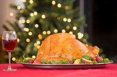 Garnished roasted turkey on holiday with red wine Stock Images