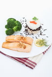 Garnished salmon kept in plate Stock Images