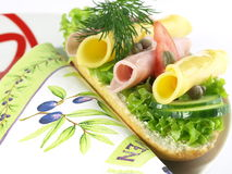 Garnished sandwich on decorative plate and napkin Stock Images